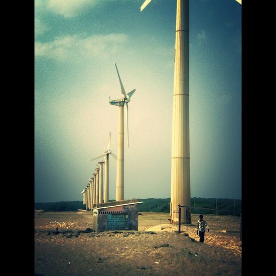 When the winds of change blow, some people build walls and others build windmills. Windmill Blue Sky Sand Beach Kutch LongTimeAgo  Trip Photography Picoftheday Pictureoftheday LetsCaptureEveythingBeforeWorldEnds Justcantgetenough De3p