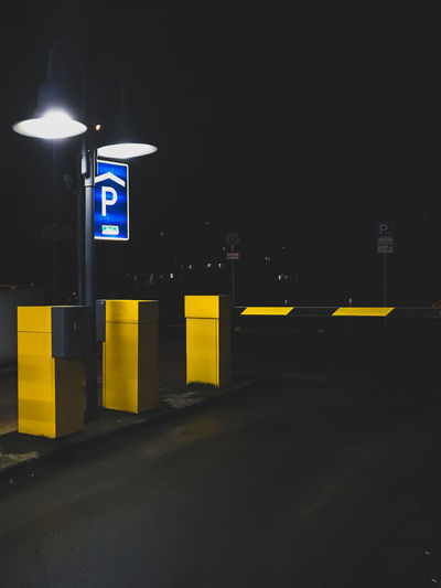 Cityscape Nightphotography ShotOnIphone Yellow Flower Cinematography Cityshapes Communication darkness and light Guidance Illuminated Night No People Outdoors Parking Garage Road Sign Street Photography Streetphotography Urban Yellow