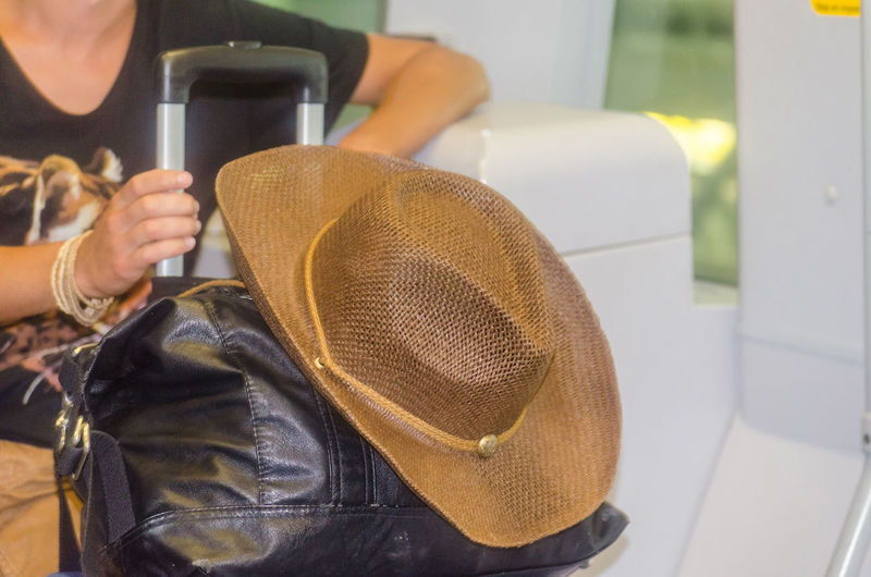 Close-up of hat on luggage