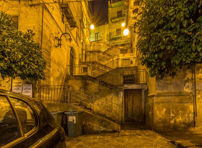 Architecture Authentic Building Built Structure City Empty Green Color Growth Illuminated Italy Lighting Equipment Monumental  Night No People Outdoors Residential Building Residential Structure Sicily Street Light The Way Forward Tree Urbanphotography