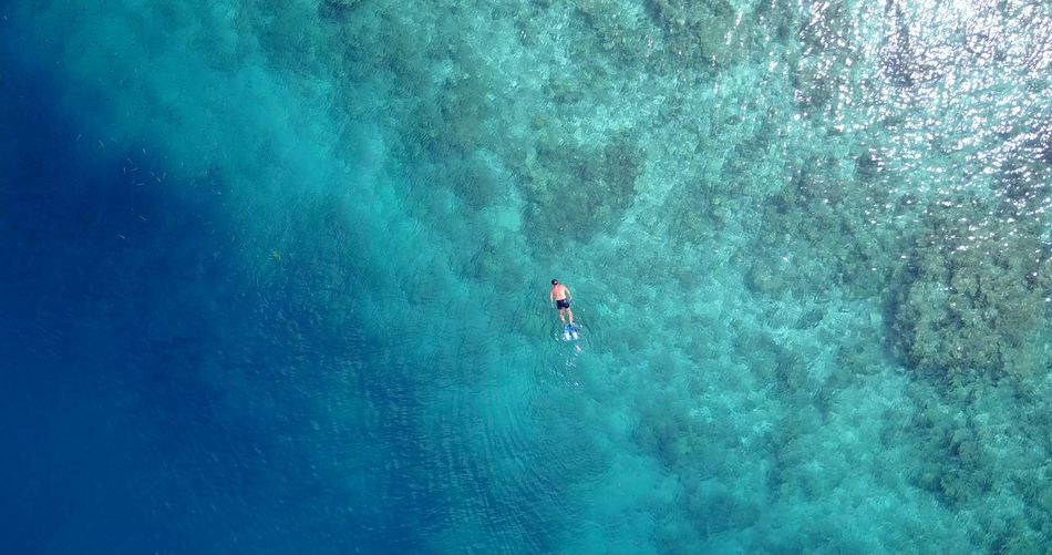 Aerial flying drone view of Maldives white sandy beach swimming snorkelling on sunny tropical paradise island with aqua blue sky sea Aerial Aqua Beach Blue Drone  Flying Island Maldives Ocean Paradise Sandy Sea Sky Snorkeling Sunny Swimming Tropical View White