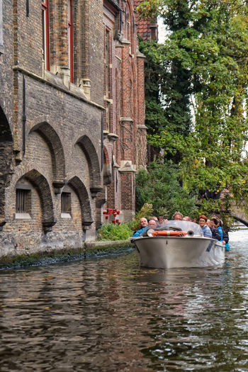A group of tourists on a canal tour in Brugge... Architecture Brugge Canal Canal Tour Canals And Waterways Check This Out Enjoy The New Normal Hanging Out Nautical Vessel Outdoors Real People Sonyalpha The Drive The Tourist Tourism Tourist Tree Water What Who Where Mix Yourself A Good Time Your Ticket To Europe Mobility In Mega Cities
