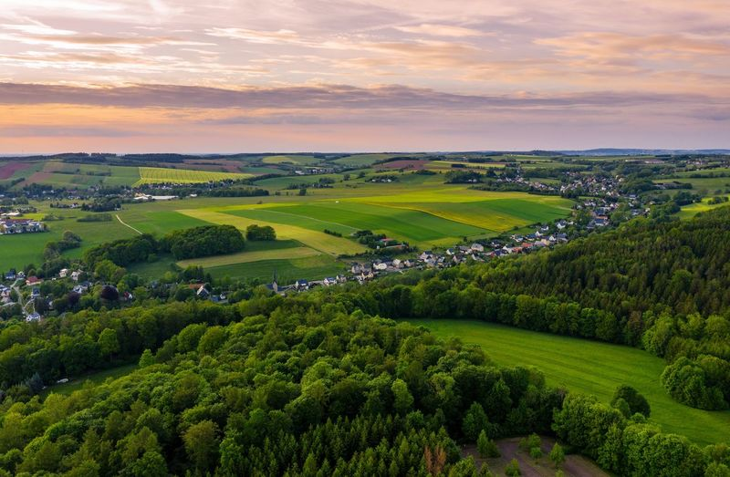 Aerial view of a small town in saxony Aerial View Aerial Image Village Town Saxony Wood Forest Green Summer Landscape Nature Hartenstein Church Tea Crop Tree Rural Scene Sunset Beauty Agriculture Summer Social Issues Forest Field Valley Moody Sky Dramatic Sky Rooftop