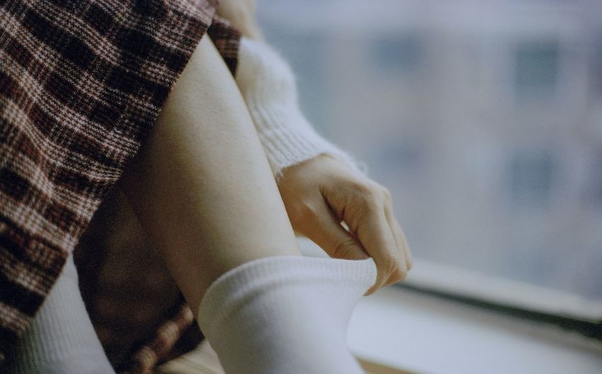 Close-up of woman hand on floor