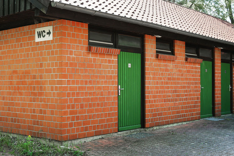 public restroom in Germany No People Day Outdoors Germany Architecture Built Structure Building Exterior Building Brick Door House Wc Toilet Public Toilet Public Bathroom Public Restroom Restroom Lavatory
