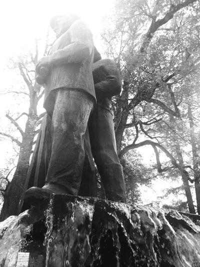 Water Fountain Statues Big Shoes Human Figure Two Men