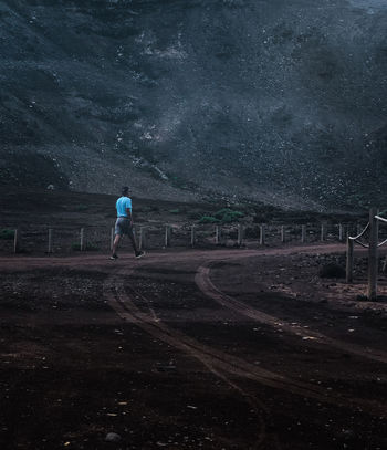 Alone Darkness Landscape Photography Nature Nightphotography Streetwear Blue Casual Clothing Desert Landscape Landscape Minimal Minimalobsession Night Night View Nightwalk One Person Outdoors People Real People Rear View Spooky Traces In The Sand Young Man Colour Your Horizn