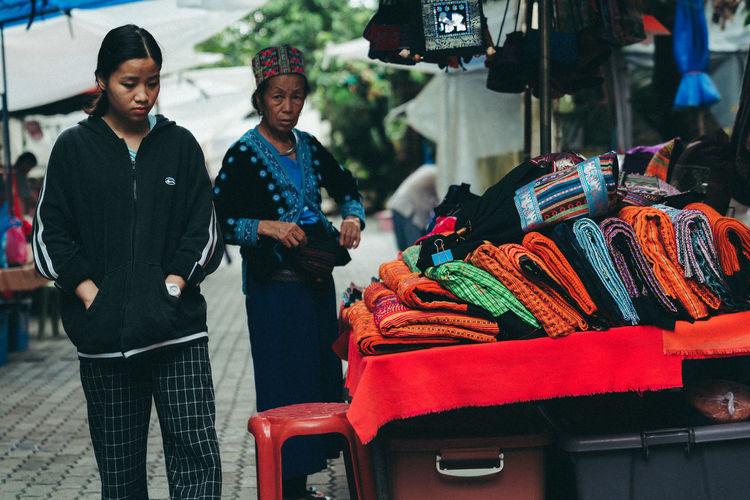 Men standing at market stall