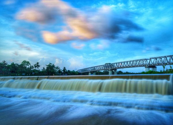 the bridge Long Exposure Shot Long Exposure Water Flow Cloudy Landsacpe Yogyakarta Senja  rule of thirds INDONESIA Photography City Sky Cloud - Sky Arch Bridge Waterfront River Boat Calm Bridge Foggy