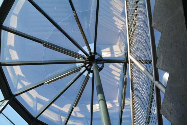 Low angle view of skylight seen through building