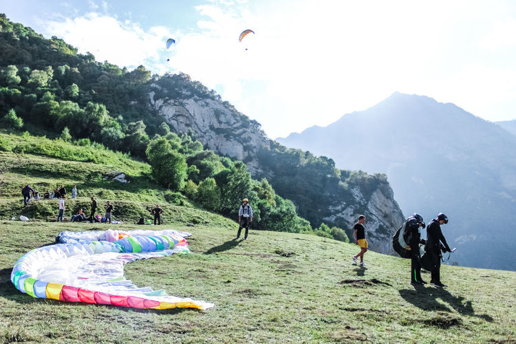 People paragliding on mountain