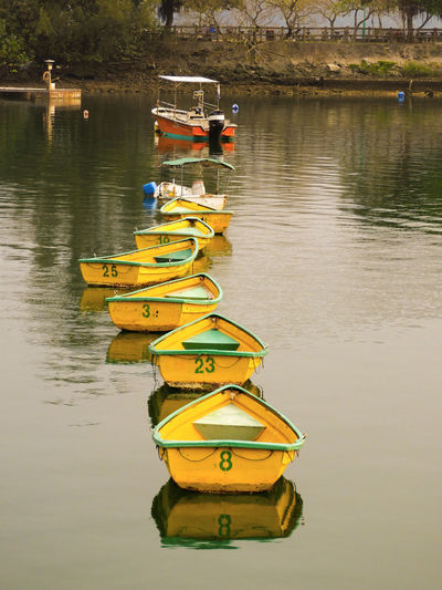 Water Nautical Vessel Yellow Multi Colored Reflection Moored Sky Pedal Boat Rowboat Recreational Boat Sport Rowing