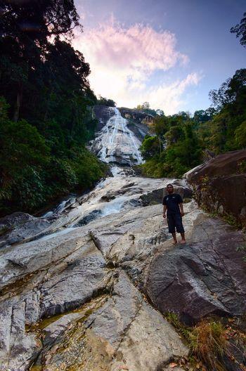 Waterfall at Gunung Stong, state park Kelantan, Malaysia. Waterfall View Scenics Landscape Amazing Waterfall Wallpaper Background Malaysia ASIA Water Tree Full Length Child Sky Hiker
