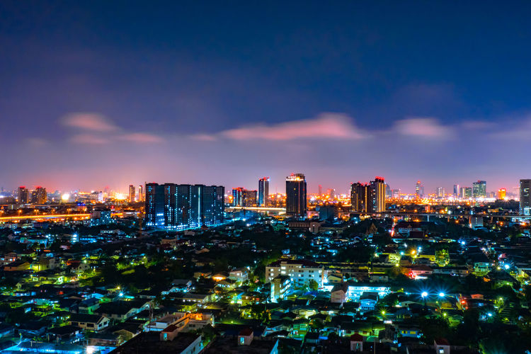Cityscape from high rise building at night with skyline and clouds. skyscraper in metropolis town with beautiful neon light Bangkok Thailand. City Night Skyline Sky View Cityscape Bangkok Thailand Travel Light Downtown Modern Panorama Road Town Twilight Landscape Building Skyscraper Architecture Evening Tower Tourism Business Beautiful Urban Asian  Landmark Street Neon Metropolis Nighttime Clouds Dark Scenics Dusk Capital Design Top Backgrounds Structure Illuminated Trails Building Exterior Cloud - Sky Office Building Exterior Outdoors Financial District  Built Structure Urban Skyline