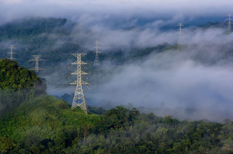 Communications tower on land against sky