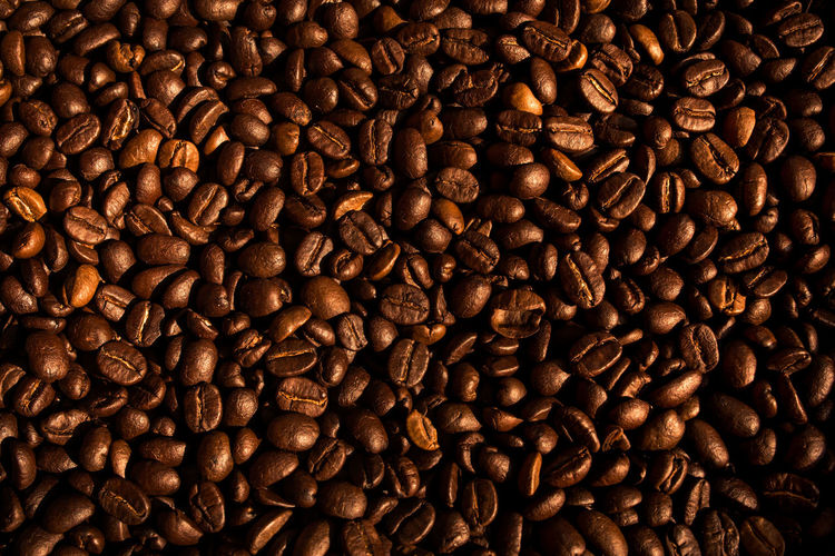 Roasted coffee beans background . Food And Drink Coffee - Drink Coffee Backgrounds Brown Full Frame Food Drink No People Close-up Coffee Bean High Angle View Roasted Coffee Bean Freshness