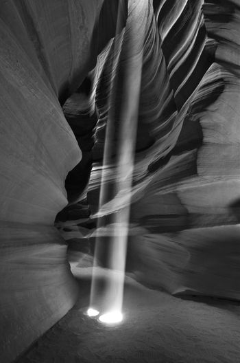 Light shaft in Antelope Canyon Natural Rock Formation Striking Stunning Sunlight USA Antelope Canyon Attractive Catching The Light Emotion Eroded Erosion Leisure Activity Light Shaft Mono Monochrome monochrome photography Mood Nature No People Pattern Slot Canyon Texture Travel Destination Vertical