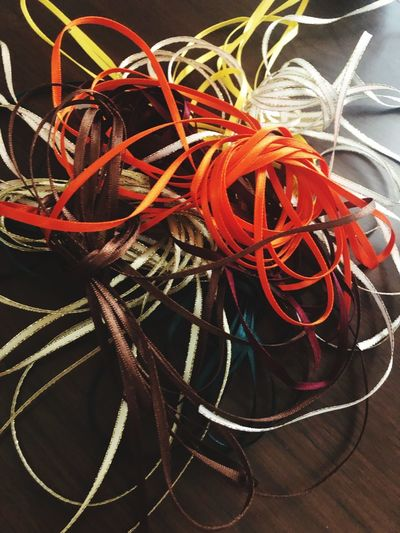 High Angle View Tangled Rope No People Close-up Still Life Complexity Decoration String Red Multi Colored Day Fishing Industry Indoors  Pattern Plant Table Sunlight Backgrounds Nature