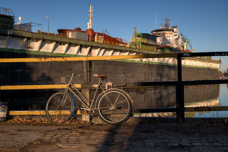 vintage ship and bike Ship Container Ship Container City Bicycle Bridge - Man Made Structure Sunny Blue Water Sky Architecture Boat Parking Bicycle Basket Cycling