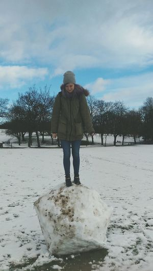 I'm an evil boyfriend. Placed my girlfriend on top of a large snow ball and she can't get down.