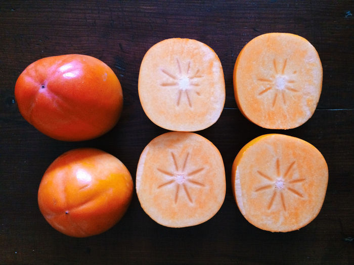 Directly above view of fresh persimmons on table