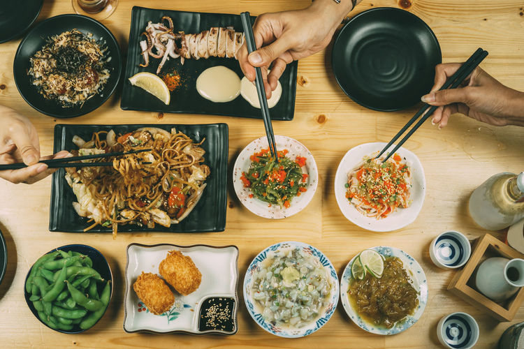 Bowl Chopsticks Cooked Directly Above Food Food And Drink Fork Freshness Healthy Eating High Angle View Holding Homemade Human Body Part Human Hand Indoors  Meal Meat Men One Person Plate Ready-to-eat Real People Serving Size Serving Tongs Table