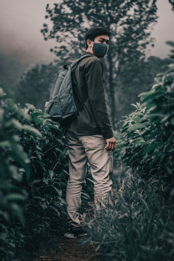 Full length of man walking on field