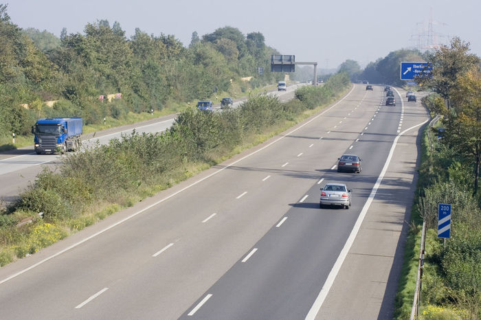 three-lane autobahn - oberhausen, germany A42 Air Pollution Autobahn Car Driving Environment Freeway Germany High Angle View Highway Highways&Freeways Land Vehicle Low Mode Of Transport No People NRW Oberhausen On The Move Pollution Road Ruhrgebiet Three-lane Traffic Transit Transportation