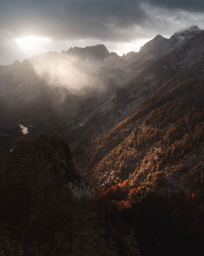 Mountain Scenics - Nature Beauty In Nature Landscape Nature Sky No People Sunlight Sunbeam Outdoors Idyllic Mountain Peak Alps Cloudscape Autumn Fall Sunset Sunrays Fog Haze Weather Mood Moody Sky Dramatic Sky Film