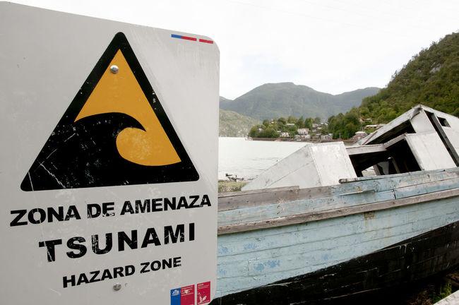 Tsunami Hazard Zone Sign - Caleta Tortel - Chile Caleta Chile Hazard Zone Sign Caleta Tortel Cove Hazard Patagonia Tsunami Tsunami Sign Warning Sign
