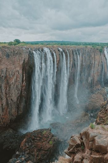 Vic Falls Water Scenics - Nature Beauty In Nature Sky Cloud - Sky Nature Motion Rock Waterfall Non-urban Scene Rock - Object Land Splashing Solid Day Sea Power In Nature Idyllic No People Flowing Water