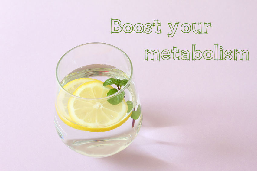 Glass of water, lemon and mint. Glass of pure water and fresh organic lemon and mint isolated on purple background. Detox and healthy food concept. Boost your metabolism text . Detox GMO FREE Glass Of Water Lifestyle Textured  Antioxidant Citrus Fruit Dieting Dring Drink Drinking Glass Food Food And Drink Freshness Fruit Glass Glass - Material Glass Of Water Isolated Glass Of Water With Lemon And Mint Healthy Eating Healthy Food Indoors  Lemon Lemons Mint No People Refreshment Still Life Studio Shot Text Water Wellbeing