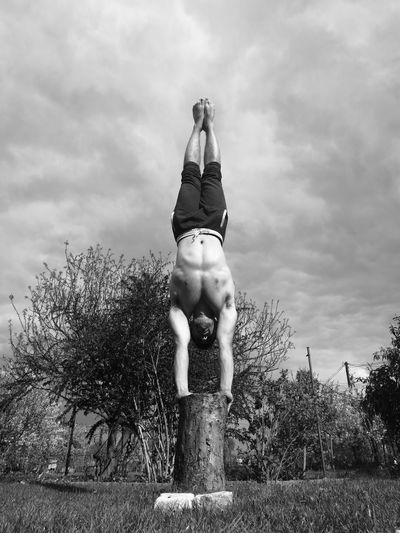 Balance Outdoors Tree Nature One Person People Human Body Part Human Nature Handstand  Movement Freedom Clouds Meditation Concentration Monochrome Photography