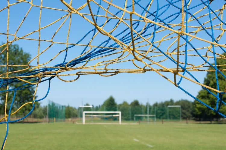 Sports Field Sports Ground Playing Field Blue Sky Goal Mesh Football Field Green Blue Close-up Close Up Selective Focus Focus On Foreground Sports Sport Equipment Football Colour Of Life