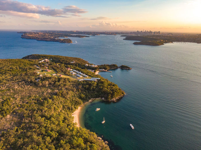 Aerial drone evening view of the Quarantine Station, part of Sydney Harbour National Park. Store Beach in foreground. Sydney harbour with North Head & South Head and city skyline in background. Manly  Manly Beach Store Beach Sydney Sydney, Australia Australia New South Wales  Beeach Bay Q Station Quarantine Quarantine Station Sydney Harbour  Sydney Harbour National Park National Park Aerial View Aerial Drone  Dronephotography Drone View High Angle View Event Sunset Sunset_collection Forest North Head South Head North Head Sydney Water Sea Scenics - Nature Beauty In Nature Nature Sky Cloud - Sky Land No People Outdoors Beach Tranquil Scene Horizon Over Water Building Exterior Coastline Idyllic Tranquility