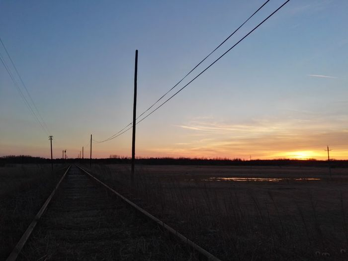 Sunset Sky Water Nature No People Beauty In Nature Dramatic Sky Outdoors Train Tracks Lines
