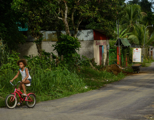 Costa Rica Architecture Bicycle Building Exterior Built Structure Cahuita Childhood Day Girls One Person Outdoors People Transportation Tree