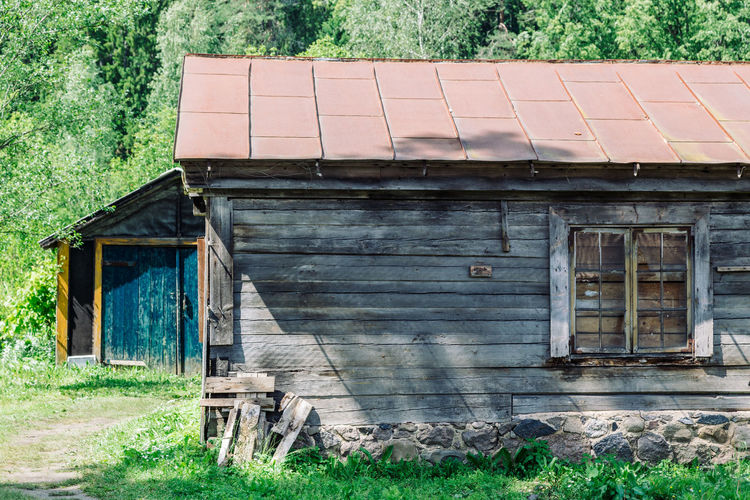 Agricultural Building Architecture Building Building Exterior Built Structure Cottage Day Field Grass Green Color House Land Landscape Nature No People Old Outdoors Plant Residential District Roof Rural Scene Wood - Material