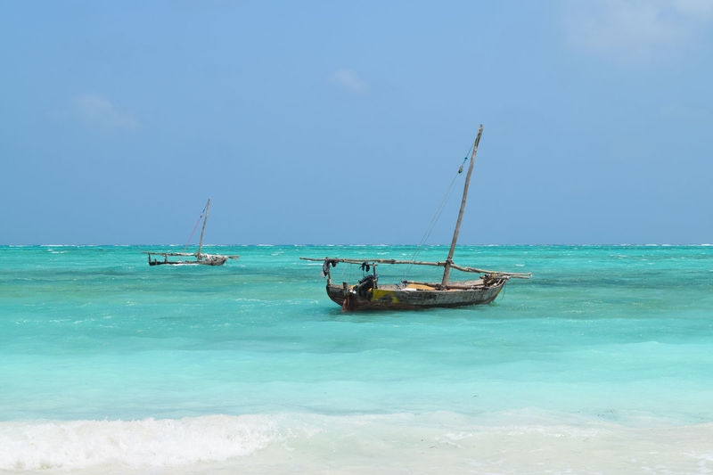 Blue water in Zanzibar Beach Beachinspector.com Beachphotography Beauty In Nature Bestoftheday Blue Boat Boats Check This Out Chilling Goodlife Idyllic Nautical Vessel No People Non-urban Scene Outdoors Relax Sea Travel Travel Destinations Water Zanzibar