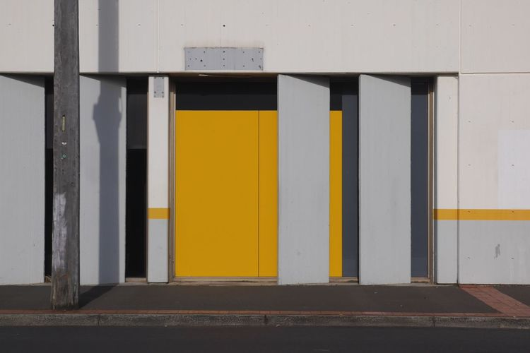 Learn & Shoot: Simplicity EyeEm Best Shots EyeEm EyeEm Gallery Street Photography Pattern Pieces Yellow Wall Achitecture Building Shadow Grey Pavement