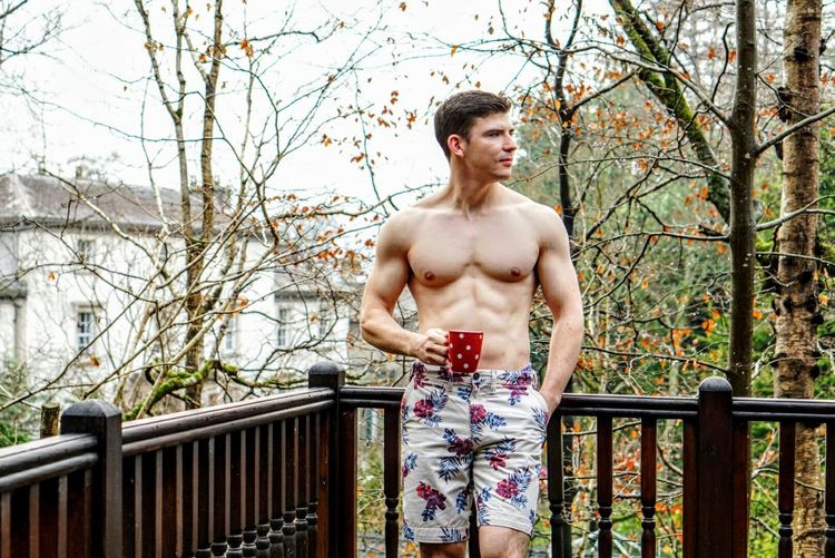 Portrait Of Shirtless Man On Balcony