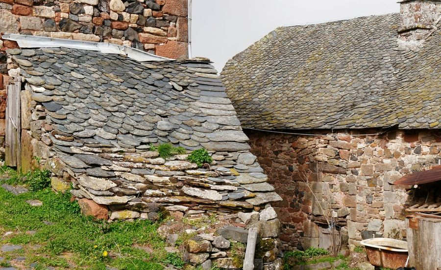 Roquelaure Multi Colored Colors Stone Material Stone Wall Roof Fern Basalt Basaltic Rock Bath Aveyron Village Rural Rural Scene History Architecture Building Exterior Sky Built Structure Stone Wall Ancient Tiled Roof  Stone Material Roof Tile