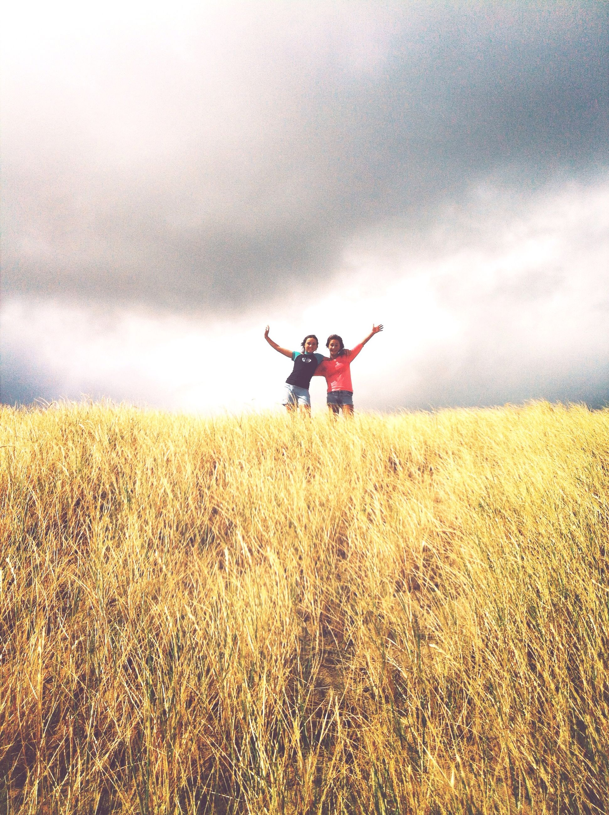 sky, lifestyles, cloud - sky, field, leisure activity, cloudy, full length, landscape, grass, cloud, tranquil scene, men, grassy, nature, tranquility, overcast, scenics, beauty in nature