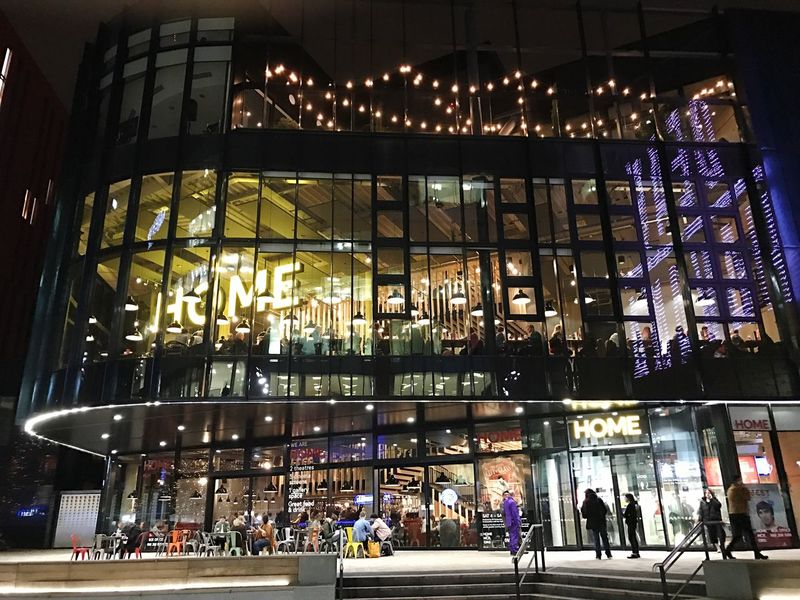 HOME Manchester Illuminated Architecture Built Structure Night Building Exterior Modern City Indoors  People Arts Culture And Entertainment Art Centre Theatre Cinema Restaurant Bar Nice Place To Relax