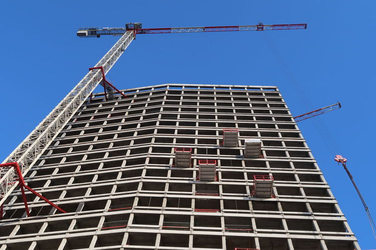 Antwerp, Belgium - December 4, 2018; The construction of Antwerp tower a skyscraper with apartments being built in the center of Antwerp, Belgium Construction Construction Site Antwerp Tower Built Structure Architecture Building Exterior Sky Building Industry Crane - Construction Machinery Construction Equipment Development Construction Industry Low Angle View Skyscraper