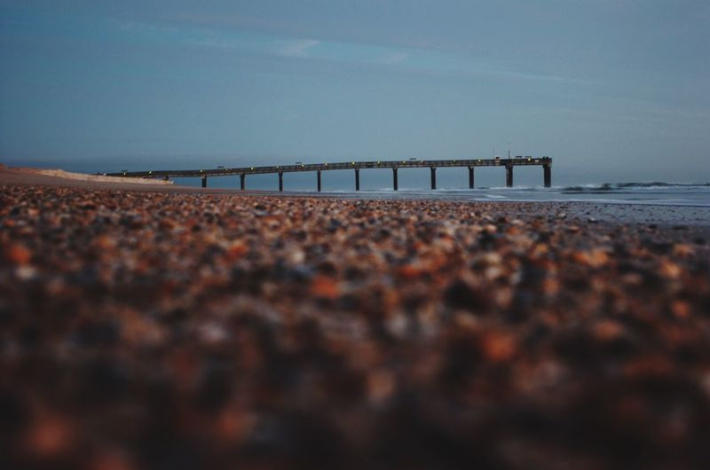 Mid distance shot of jetty over calm sea