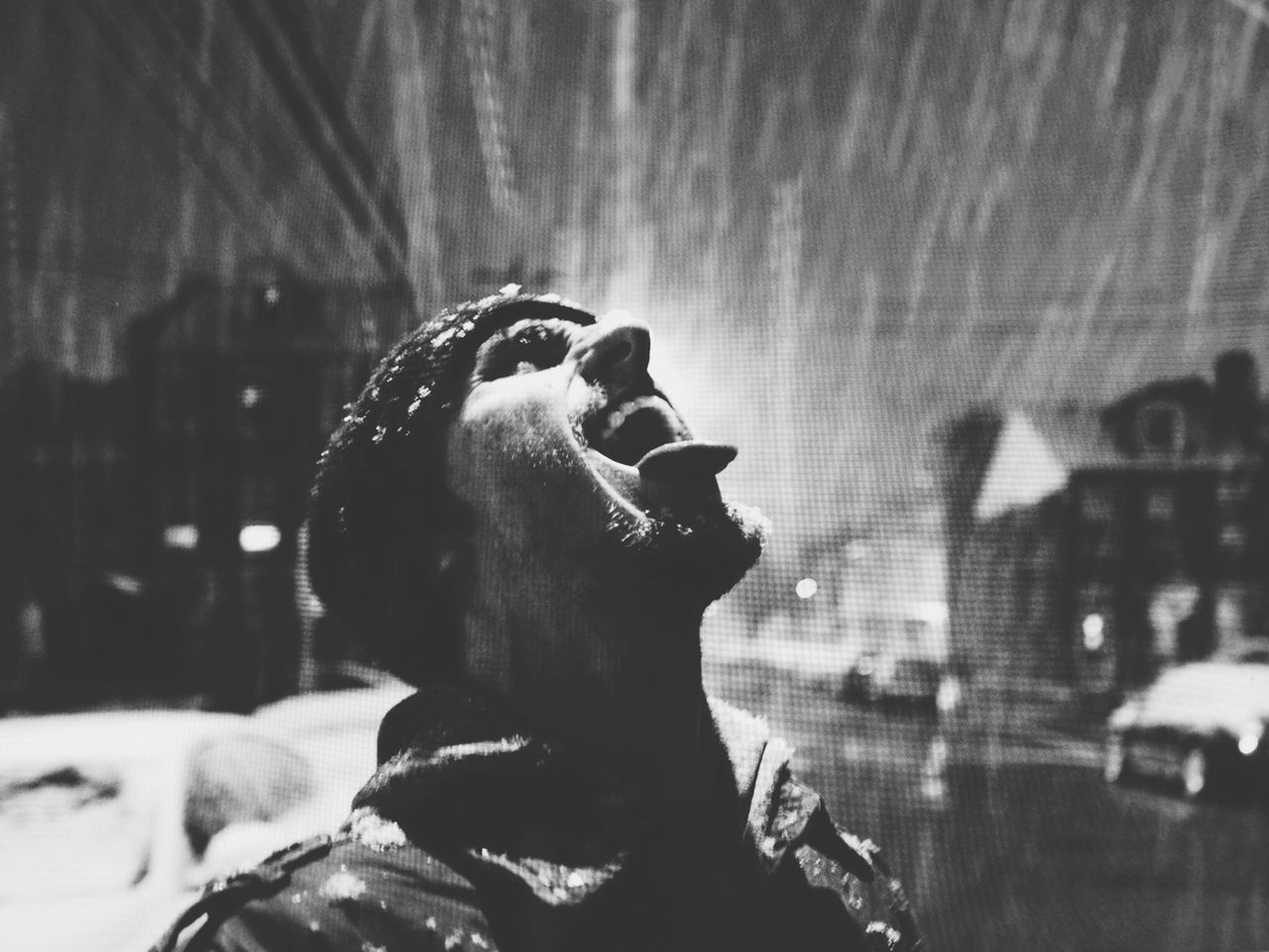 Close-up of man opening his mouth while snowing