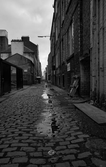City Sky Architecture Building Exterior Built Structure Cobbled Puddle Alley Empty Road vanishing point Rain Narrow The Way Forward Old Town Road Marking Historic Paving Stone Wet Cobblestone
