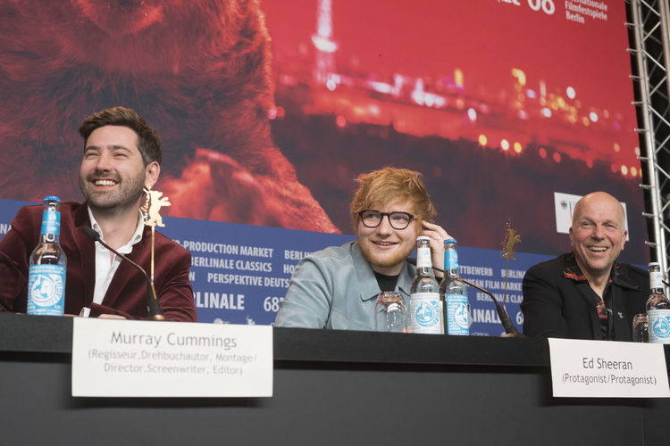 Berlin, Germany - February 23, 2018: English director Murray Cummings and singer, guitarist Ed Sheeran with host Anatol Weber attend the 'Songwriter' press conference at 68th Berlinale 2018 Artist Celebrity Ed Sheeran Ed Sheeran <3 Ed Sheraan❤ Famous Press Singer  Singer/Song Writer Anatol Weber Berlinale Berlinale 2018 Berlinale Festival Berlinale2018 Berlinale68 Celebrities Communication Famous People Front View Murray Cummings Portrait Press Conference Singer And Artist Song Writer Speech