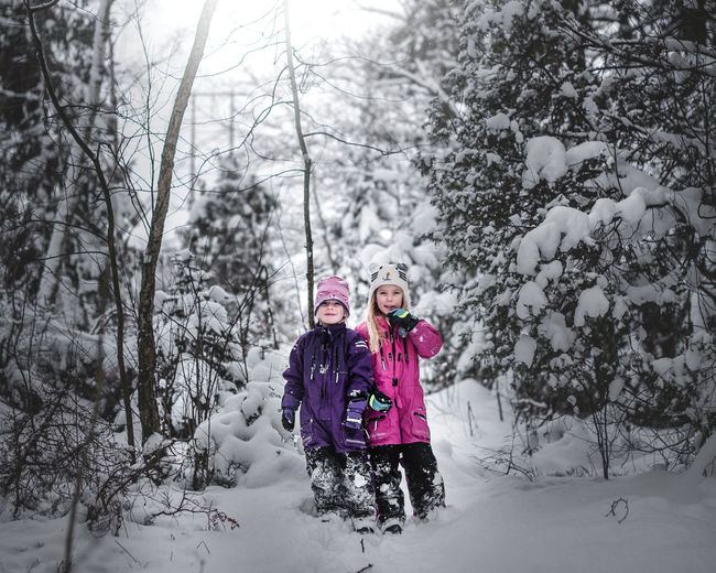 Bonding Childhood Cold Temperature Females Forest Girls Outdoors Smiling Snow Togetherness Two People Warm Clothing Winter